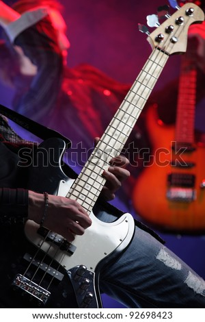 rock musicians playing at a live concert, similar photo on my portfolio