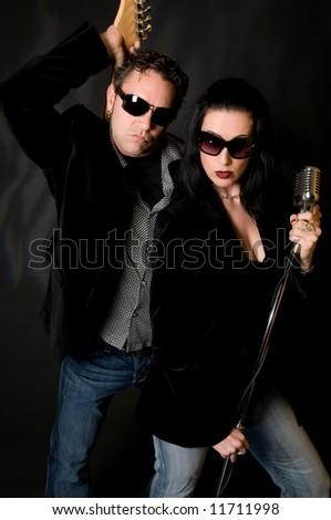 Rock musicians posing for a promo shot