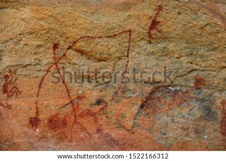 """Rock painting in the region of """"Serra da Capivara"""" - State of Piaui - Northeast Brazil. The picture seems to depict a weird tall man with very long arms."""
