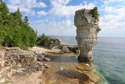 Rock pillar rise from the waters of Georgian Bay on Flowerpot island in Fathom Five National Marine Park, Lake Huron, Canada