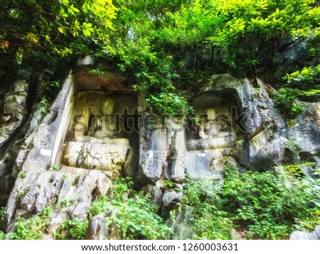 Rock reliefs at Feilai Feng at the Lingyin Temple (Temple of the Soul's Retreat) complex. One of the largest Buddhist temples in China