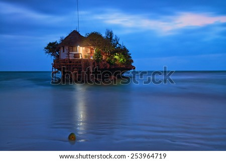 Rock romantic restaurant in Indian ocean near Zanzibar coastline