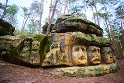 Rock sculptures of giant heads and other artworks Harfenice Harfenist) carved into the sandstone cliffs in the pine forest above village Zelizy by Vaclav Levy, Central Bohemia, Kokorin, Czech republic