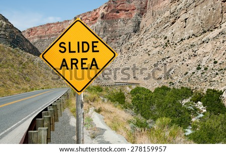 Rock Slide Area Warning Sign:  A sign informs motorists of a rock slide area ahead on a mountain road in northeast Wyoming.
