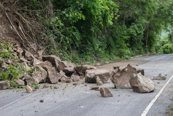 Rock sliding blocks the road