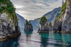 Rock Spires in the Turquoise Water of Spire Cove in the Kenai Fjords National Park