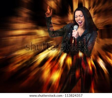 Rock star. Sexy woman singing. Karaoke.