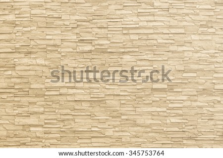 Rock stone brick tile wall aged texture detailed pattern background in light yellow cream  brown color tone: Grunge ancient rustic limestone patterned backdrop for decoration in  beige toned colour