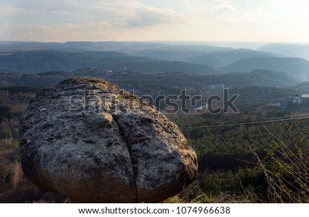 rock, stone over a mountain valley in the haze, the northern Caucasus, the Caucasus Mountains