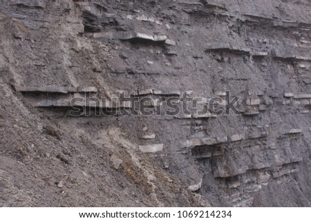 Rock strata of the Dorset coast, clearly showing the different layers of sediment. #1069214234