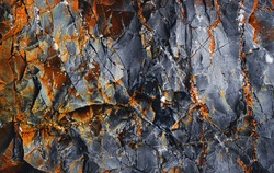 Rock surface with cracks. Grunge Mountain. Abstract texture. Stone black wall. Rock texture. Stone background. Stone mineral texture. Rock pile background. Rough structure.