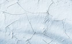 Rock surface with cracks. Painted Abstract Wall. Cracked ice. White Background. Abstract texture. Rock texture. Stone background. Stone mineral texture. Rock pile background. Rough structure.