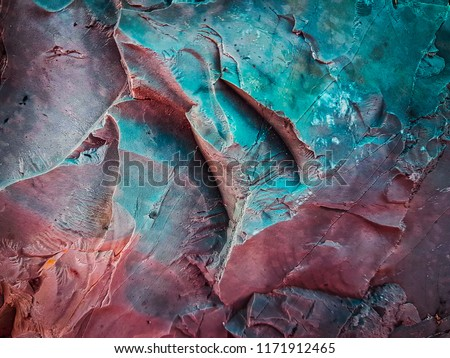 Rock texture. Dark stone wall. Stone background. Rock surface with holography, nacre. Fantasy wallpaper stock photo