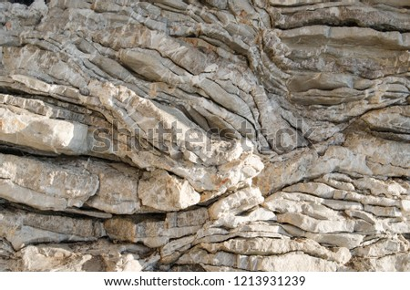 Rock, the background of the layers of ancient sediments.Layered stone. #1213931239