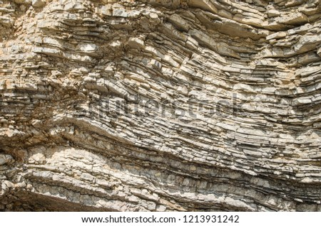 Rock, the background of the layers of ancient sediments.Layered stone. #1213931242