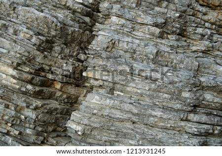 Rock, the background of the layers of ancient sediments.Layered stone. #1213931245