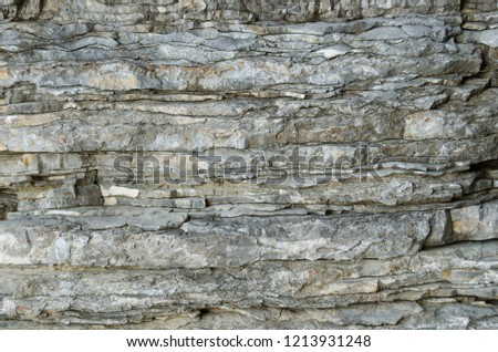 Rock, the background of the layers of ancient sediments.Layered stone. #1213931248