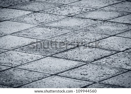 Rock tiled paved road background pattern