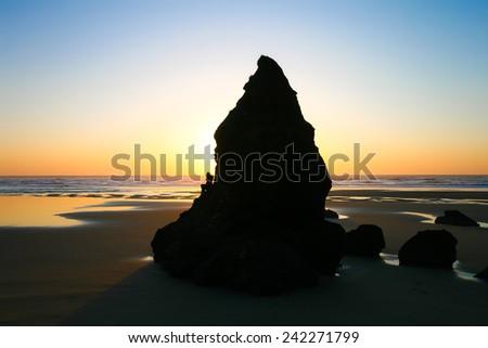 Rock Tower at Heceta Head Beach at Sunset, Oregon, USA