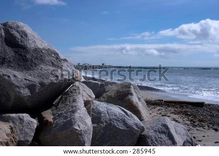 rock wall and beach - stock photo