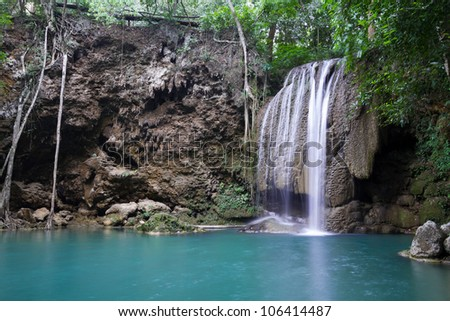 Rock, waterfall and blue lake in the forest (Erawan Waterfall) in Thailand