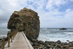 Rock with pathway on the beach, Playa del Roque de las Bodegas, Tenerife North