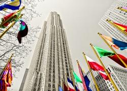 Rockefeller Center among flags