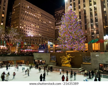 Rockefeller Center, New York, Dec 5th 2008: Ice skaters and tourists are all around the famous Rockefeller Center Christmas tree during the holidays.