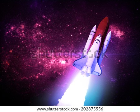 Rocket Against Starry Background - Elements of this Image Furnished By NASA