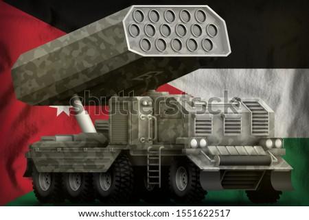 rocket artillery, missile launcher with grey camouflage on the Jordan flag background. 3d Illustration