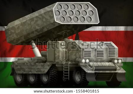 rocket artillery, missile launcher with grey camouflage on the Kenya flag background. 3d Illustration