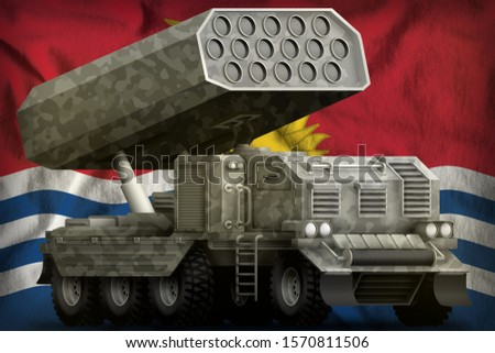 rocket artillery, missile launcher with grey camouflage on the Kiribati flag background. 3d Illustration