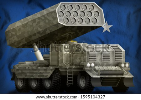 rocket artillery, missile launcher with grey camouflage on the Kosovo flag background. 3d Illustration