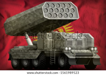 rocket artillery, missile launcher with grey camouflage on the Kyrgyzstan flag background. 3d Illustration