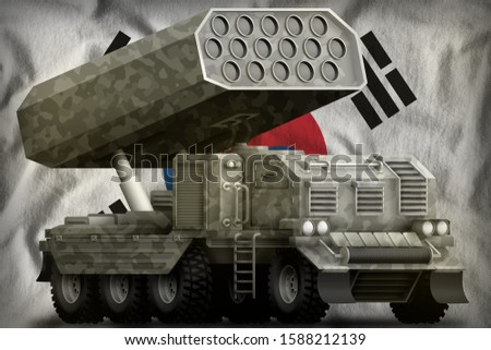 rocket artillery, missile launcher with grey camouflage on the Republic of Korea (South Korea) flag background. 3d Illustration