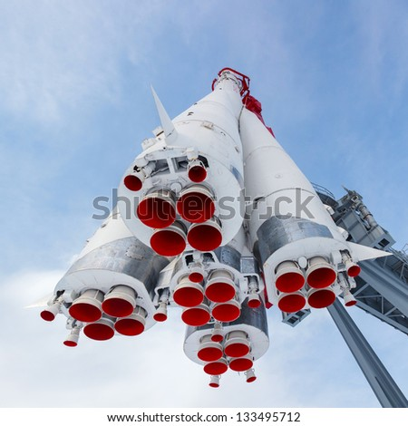 rocket engine and red nozzle engines on the background of blue sky