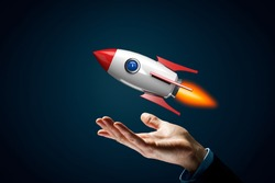 Rocket growth concept. Symbol of fast growth – hand with holding gesture and cartoon rocket flying above hand.