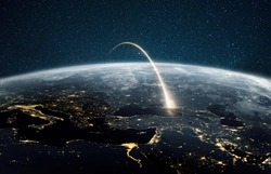 Rocket launch on a night planet earth with lights. Concept of successful satellite launch. Spaceship flies over the planet. View from space