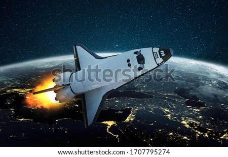 Rocket launch outer space concept. Space shuttle ship flying against the backdrop of the planet Earth with the lights of night cities. Successful start of a space mission Foto stock ©