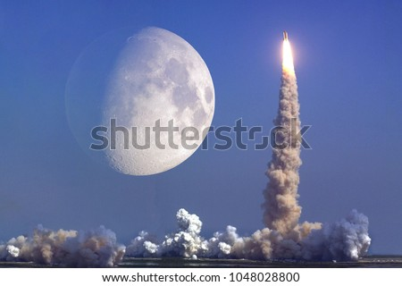 Rocket launch with moon on background. Elements of this image furnished by NASA #1048028800