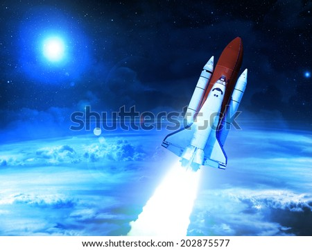 Rocket Leaving Planet Earth - Elements of this Image Furnished By NASA