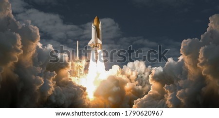 rocket stars into space. spaceship takes off into the night sky on a mission.Elements of this image furnished by NASA
