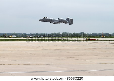 ROCKFORD, IL - JULY 31: A military A-10 Thunderbolt airplane in takeoff motion at the annual Rockford Airfest on July 31, 2010 in Rockford, IL