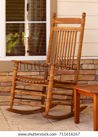 Rocking Chair On Patio   Photograph Of A Rocking Chair Next To A Window On  The