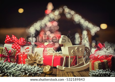 rocking horse and handmade christmas decorations on wooden boards