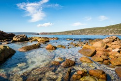 Rockpool and blue summer sky at Canal Rocks between the towns of Dunsborough and Margaret River in the South West of Western Australia, Australia.