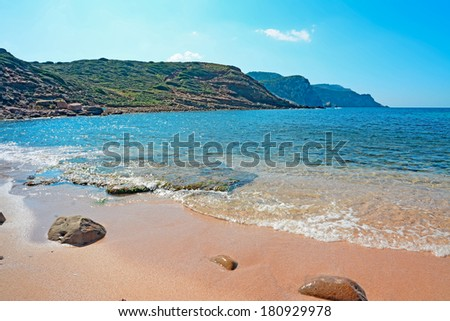 rocks and sand in a pink beach