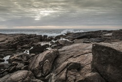 Rocks and sea - rocks with millenniums marks the oceans and their waves.