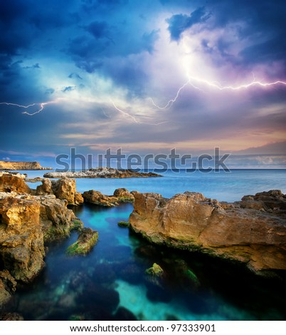 Stock Photo Rocks and sea storm. Dramatic scene. Composition of nature