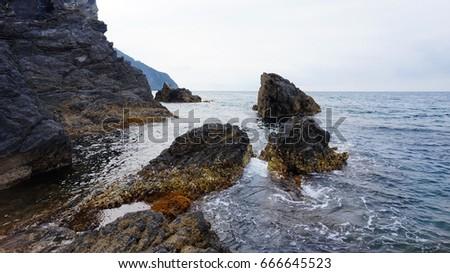 Rocks and sea. Typical seascape of Italian Riviera, Cinque Terre, Liguria, Italy #666645523